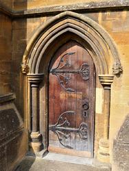Wooden door & Pershore Abbey Worcestershire